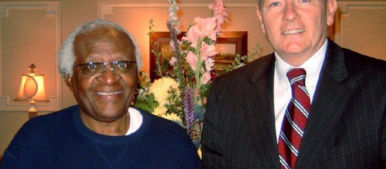 Lou Prevost of The Radnor Hotel greets Archbishop Desmond Tutu during his stay at The Radnor on October 6, 2004.