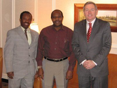Akim Gabisi, Banquet Manager, and Louis Prevost, General Manager, welcome Paul Rusesabagina, humanitarian and inspiration for the film Hotel Rwanda, to The Radnor Hotel on February 14, 2007.