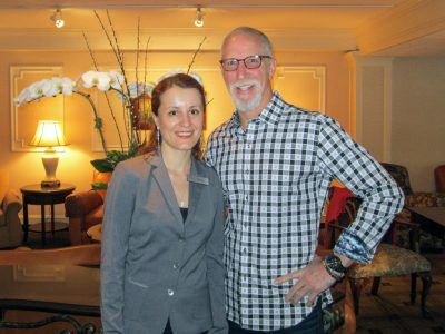 Anna Guseva, Front Office Manager, welcomes Pat Croce, Entrepreneur and Former 76ers Owner to The Radnor Hotel