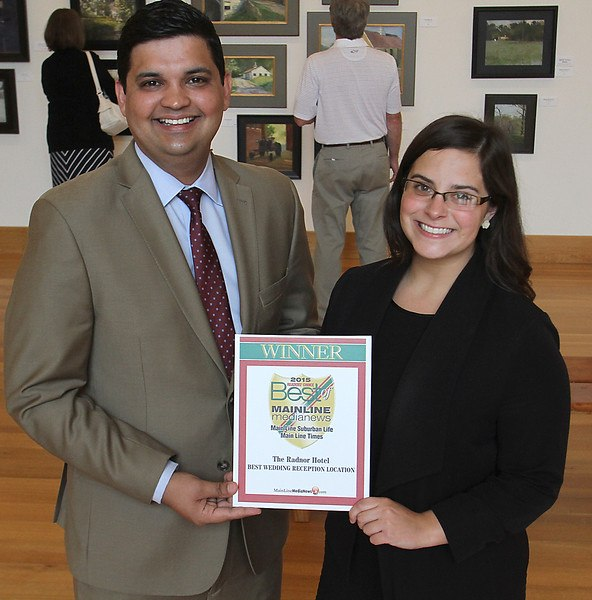 "The Radnor Hotel's Director of Food and Beverage, Sachin Siwach, and Wedding Specialist, Abbey Kovacs, accept the Main Line Media News Readers' Choice Award for ""Best Wedding Reception Location"". (Photo Credit: Pete Bannan / Main Line Media News)"