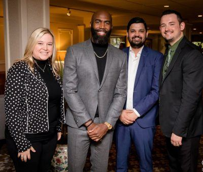 Malcolm Jenkins of the Philadelphia Eagles is welcomed by Michelle Coyle (Catering and Sales Manager), Sachin Siwach (Director of Food & Beverage), and Shane Hurley (Restaurant Manager) before his special guest appearance at the Habitat for Humanity of Montgomery and Delaware Counties 30th Anniversary Gala at The Radnor