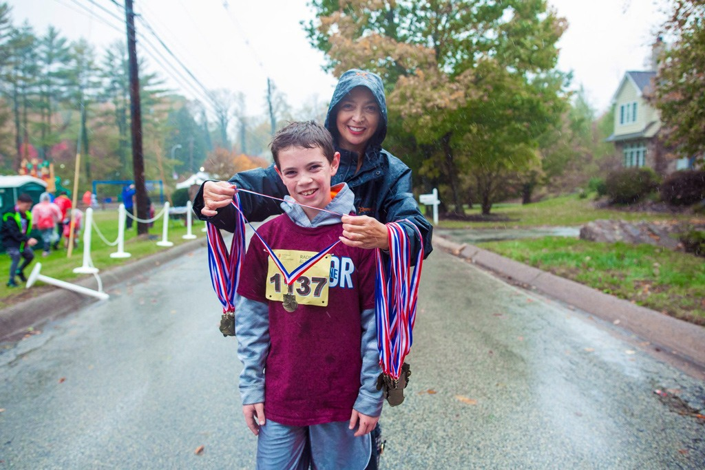 Anita Sayers of The Radnor Hotel made sure the 1-mile finishers received their medals!