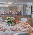 Wedding Reception at The Radnor Hotel 2021 with low centerpiece flowers looking over dance floor