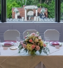 Wedding Reception at The Radnor Hotel 2021 with low centerpiece flowers looking out at wedding ceremony