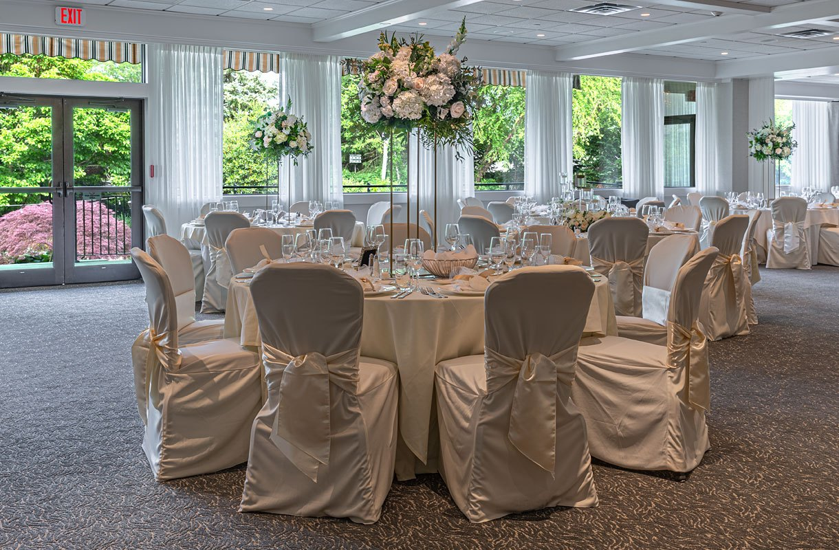 Wedding Reception at The Radnor Hotel 2021 with high centerpiece flowers